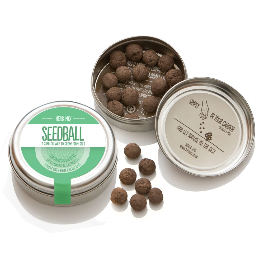 picture to show an open tin of herb mix seeds