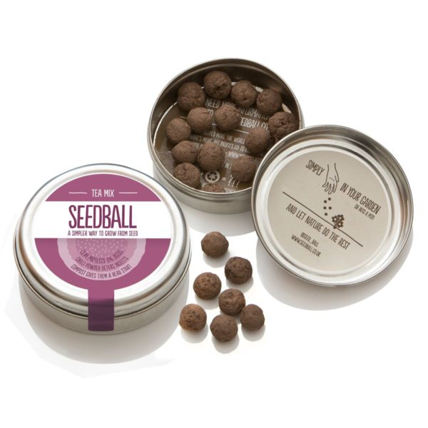 An image to show an open tin of Tea mix seed balls