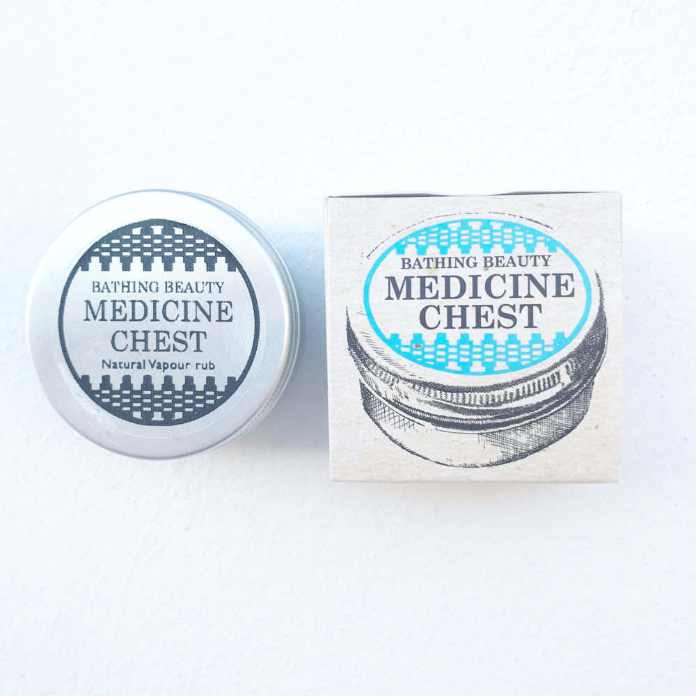 A photo showing the decorative and informative outer carton and inner jar of Medicine Chest. The Carton is compostable, the jar is recyclable
