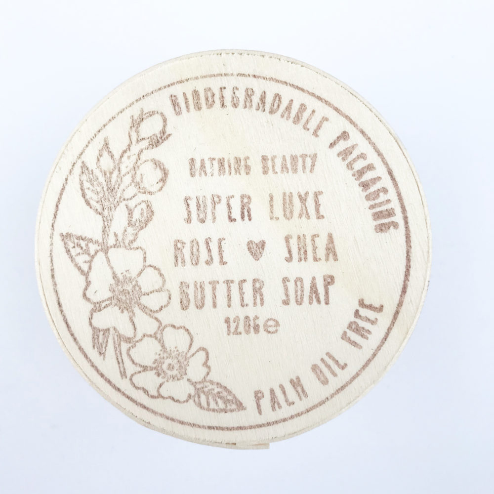 an image of the top of the wooden box which holds Rose and shea butter soap