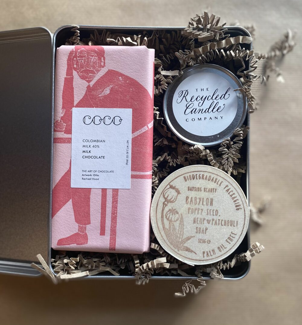 Metal Gift tin containing a bar of Rhubarb and Ginger Chocolate, Smoke scented Recycled Candle, and Patchouli csented, poppy seed studded, hemp oil enriched soap