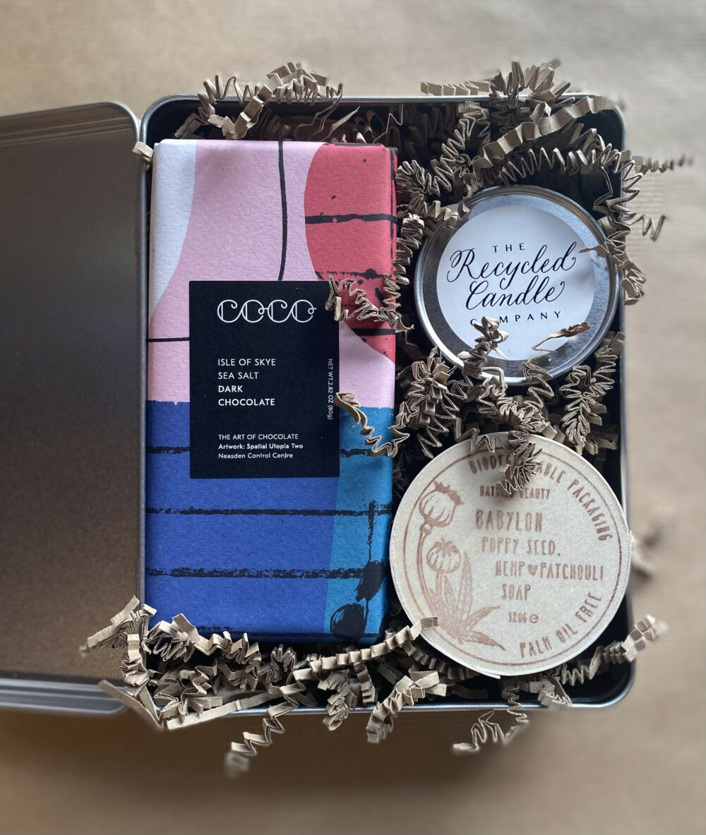 metal gift tin containing a bar of Dark Chocolate and Isle of Skye sea salt, recycled candle, and patchouli soap